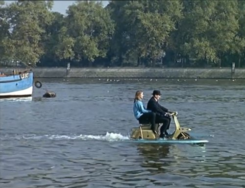 Two persons on Lambretta on water